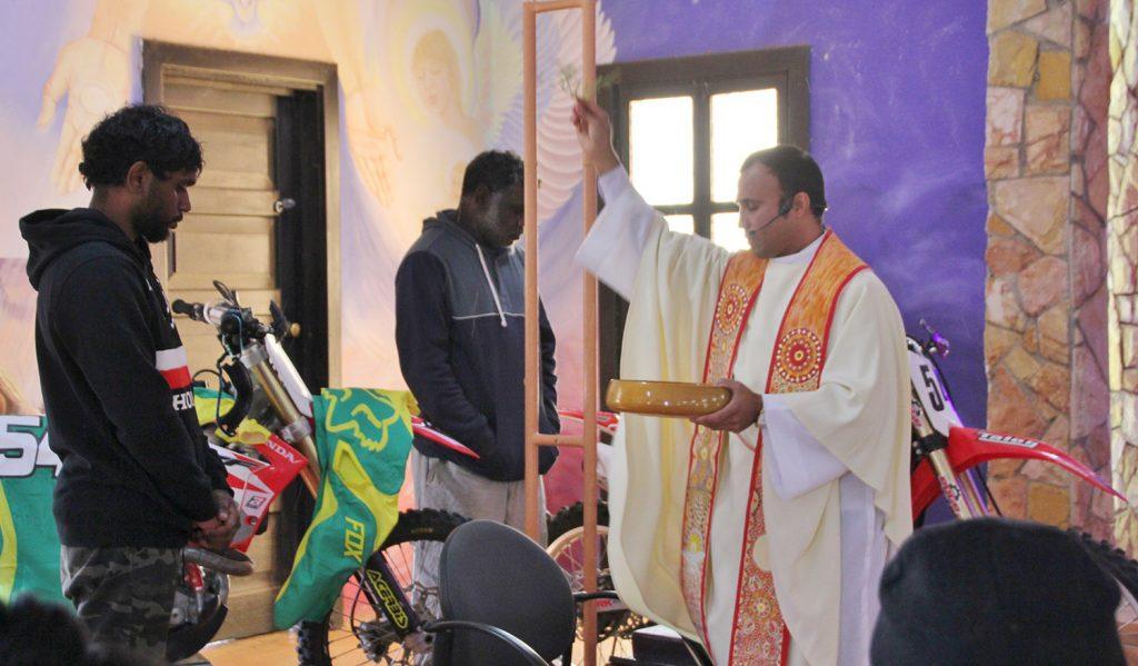 Photo of riders and Fr Prakash