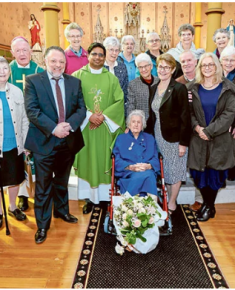 Bishop Terry Brady, Parish Priest Fr Salas Muttathukattil MSFS, parishioners and sisters including Sr Mary Constable, centre, gather for the farewell. Photo: Patrick Lee